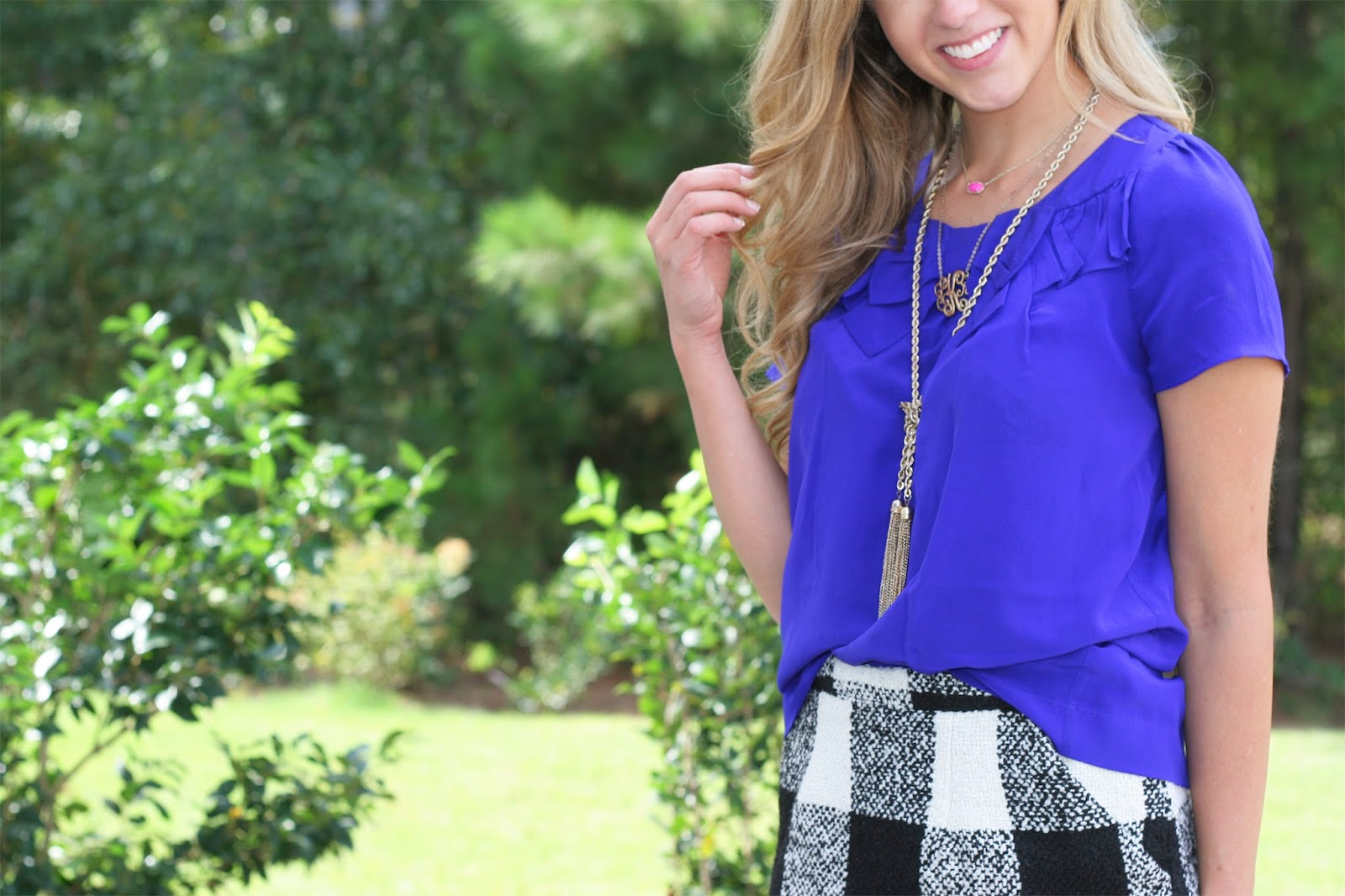 Effortless-tuck-top-for-fall-with-necklace-layers-and-patterned-skirt