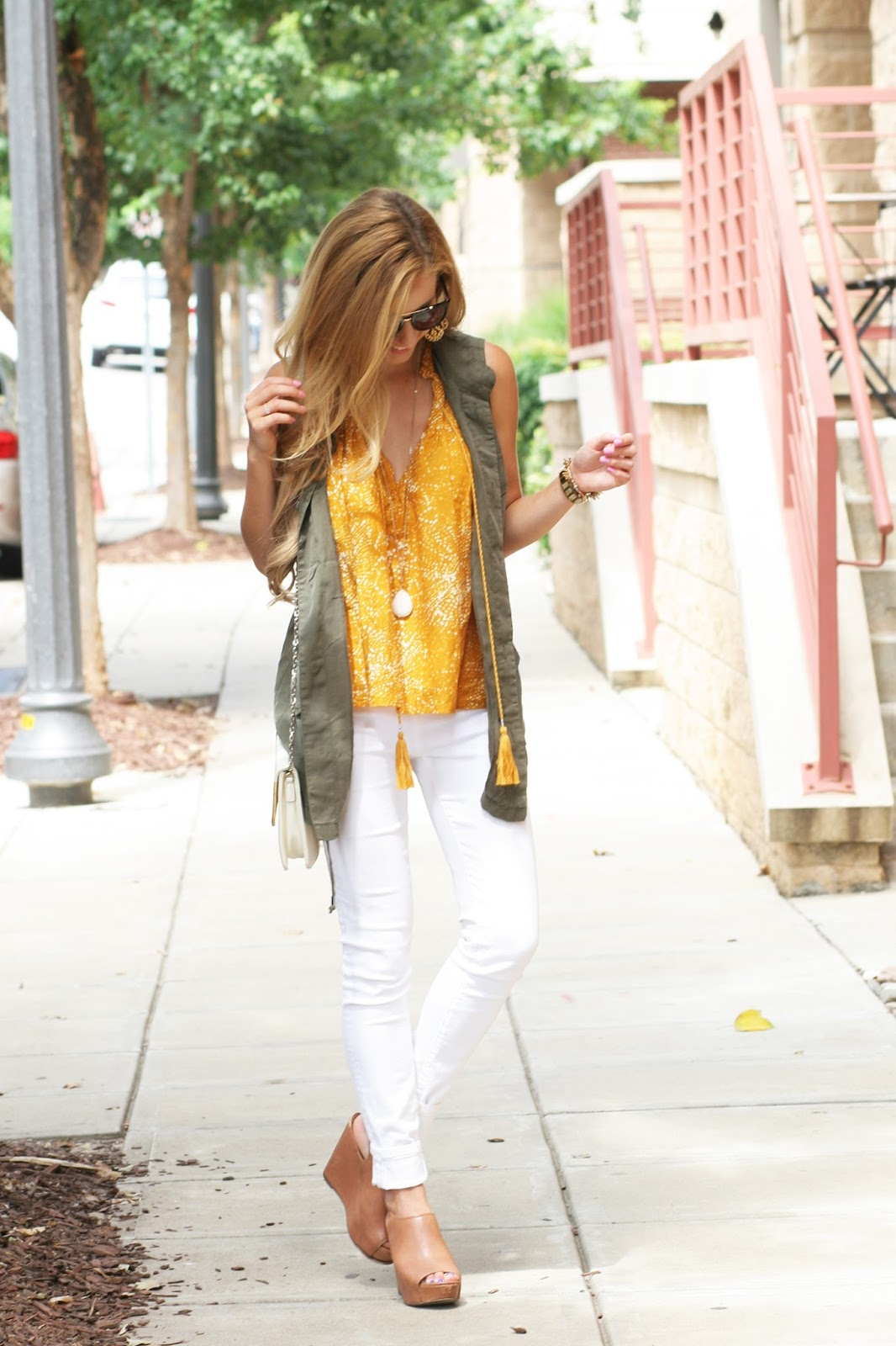 Military-green-cargo-vest-with-printed-blouse-and-wedges