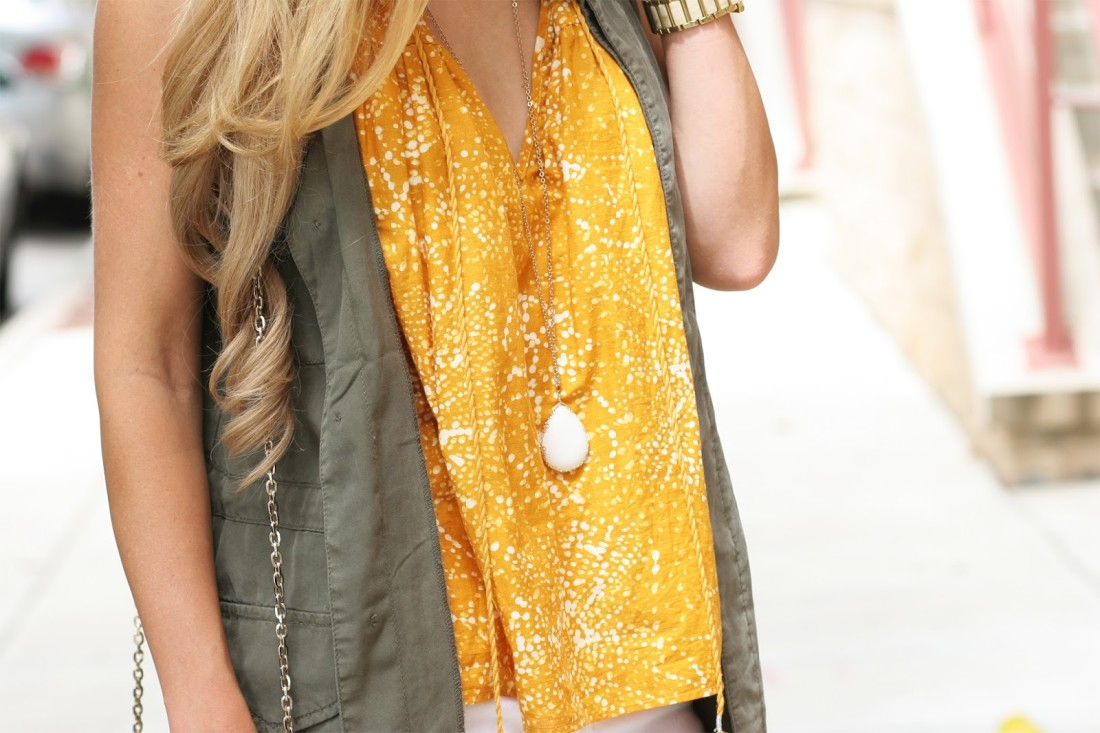 Army-green-cargo-vest-with-printed-blouse-outfit