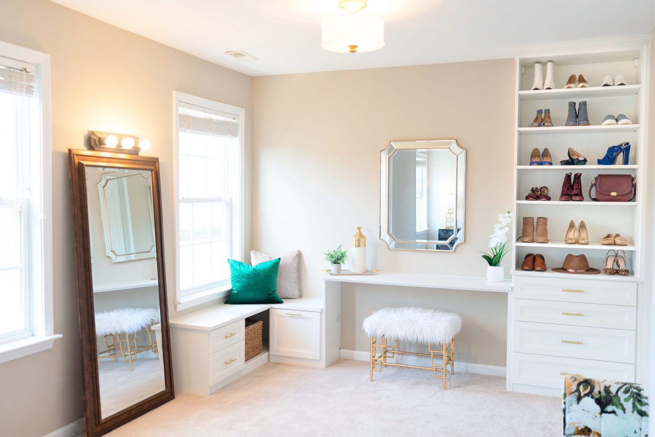 Walk in closet with window and vanity